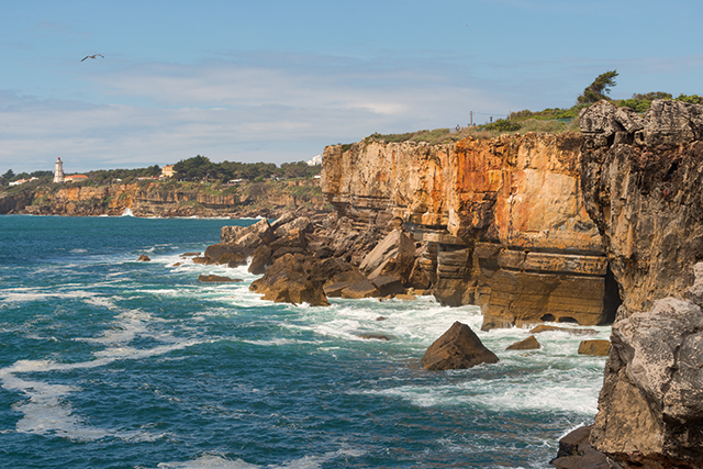 rocky cliffs along the coast in lagos portugal