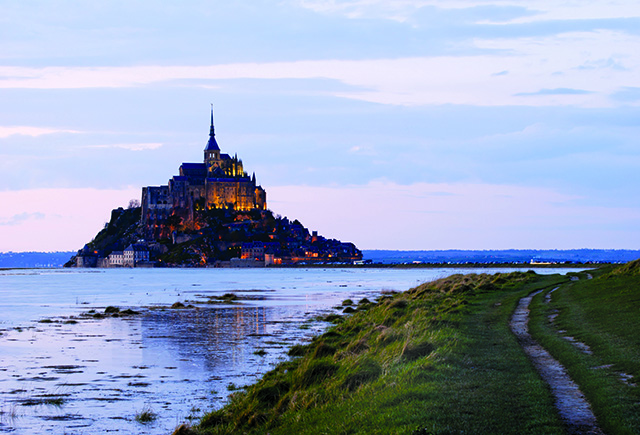 mont saint michel at sunset in normandy