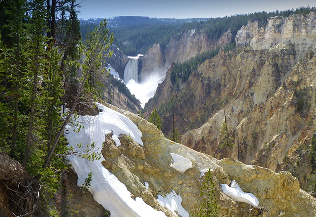 snow capped cliffs along the edge in yellowstone national park