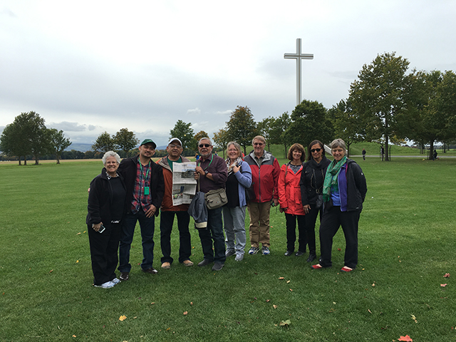 group of travelers standing together in phoenix park in dublin