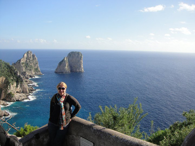 traveler standing on cliffs along the Amalfi Coast in Italy