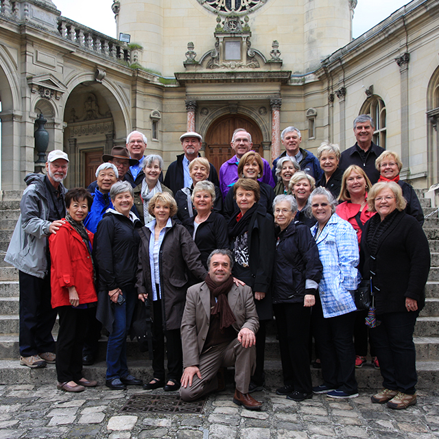 group of travelers posing together for a picture in chantilly france
