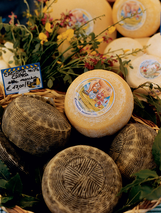 cheese wheels in a basket