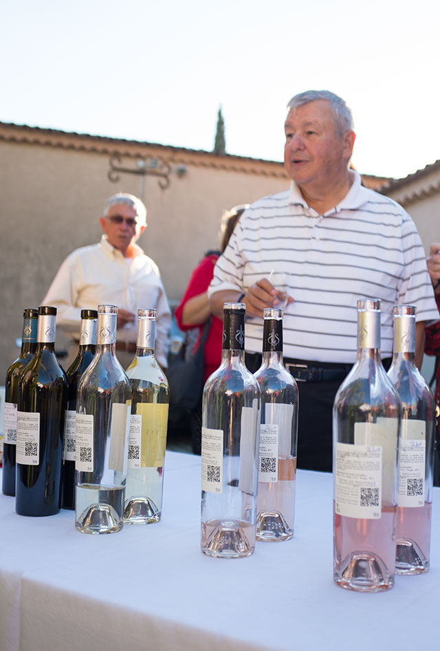 man explaining the various wines at tasting in france