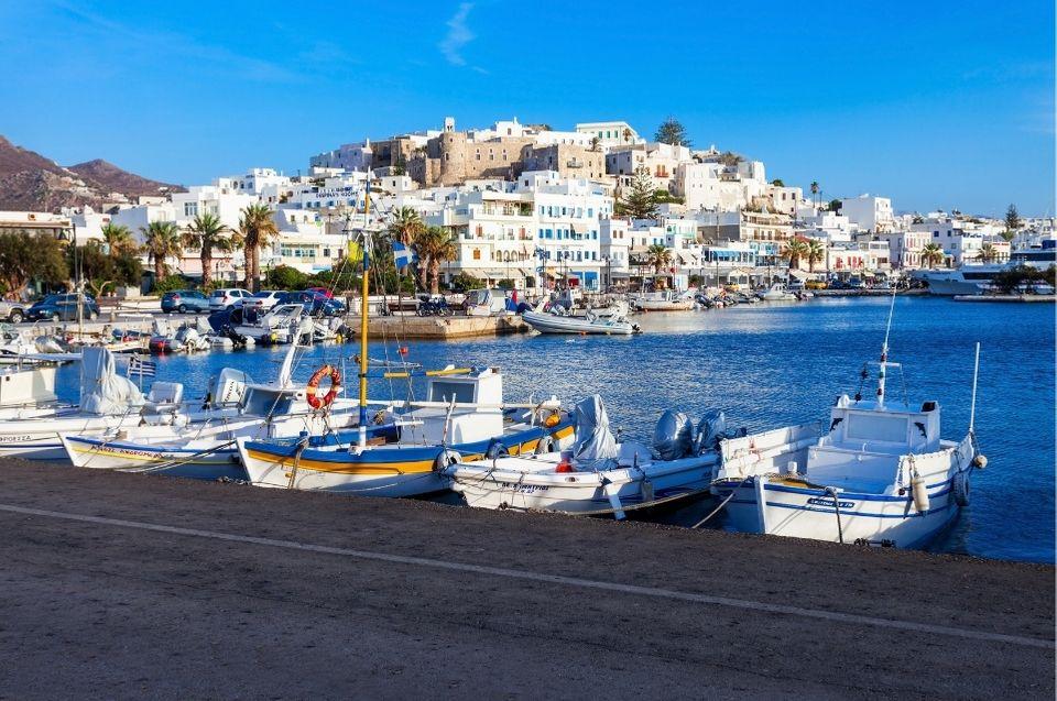 boats docked in a marina in naxos greece