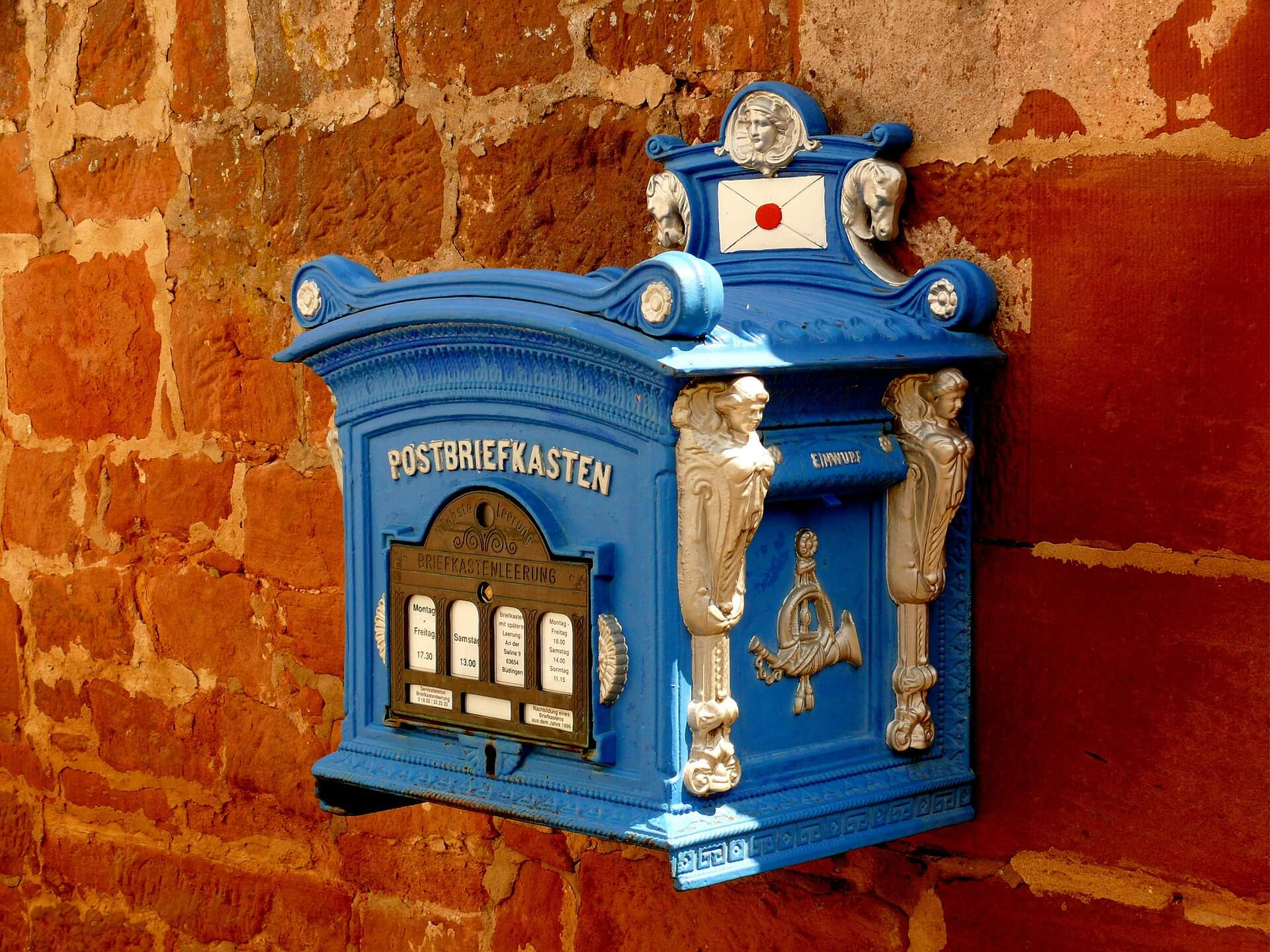 A blue old-fashioned mailbox