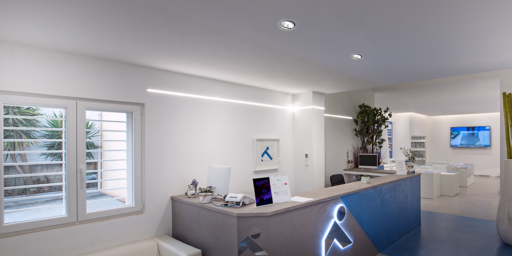 Downlights in ceiling above reception area