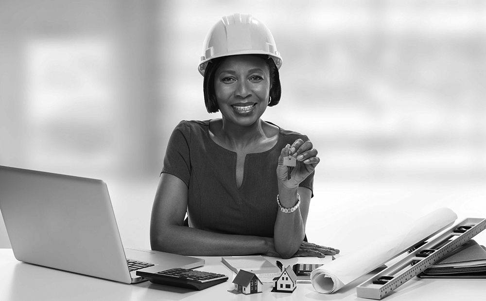 Hardhat woman smiling from a new construction loan.