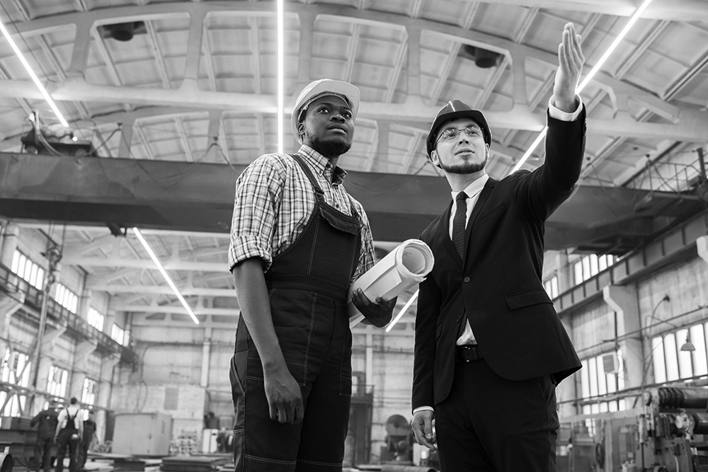 Two businessmen in a manufacturing plant.