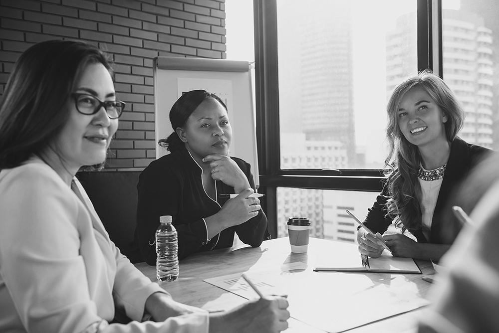 Businesswomen sitting around table
