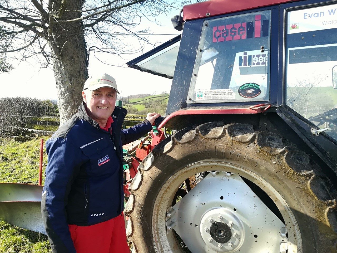 Mr Watkin stands in front of his Case 885L tractor, shod with Mitas AC85 tyres.