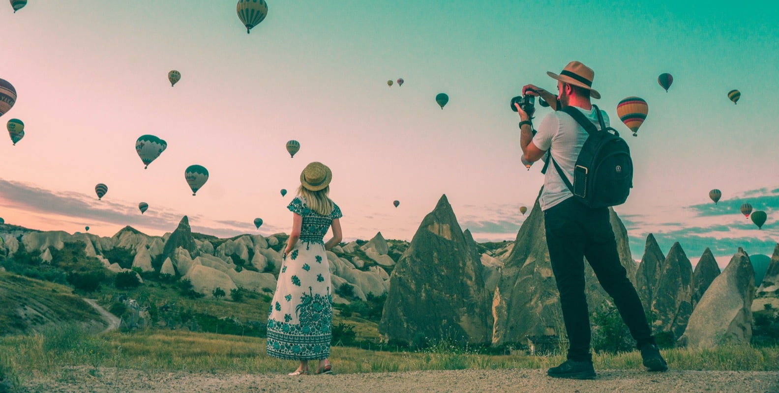 Couple taking photos of hot air balloons