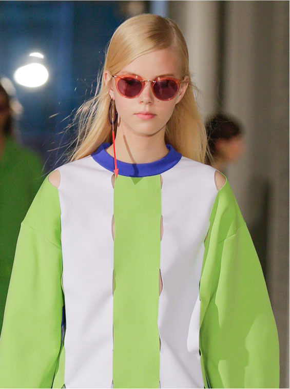Model wearing a green white dress on the catwalk with Arthur Arbesser for Silhouette eyewear