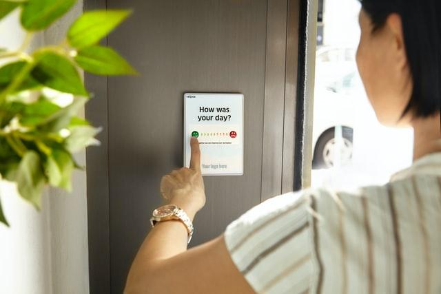 Customer giving feedback on tablet