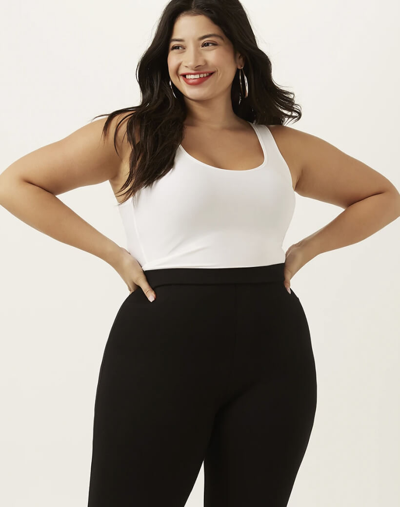 Plus Woman in White Tank Top and Black Jeans