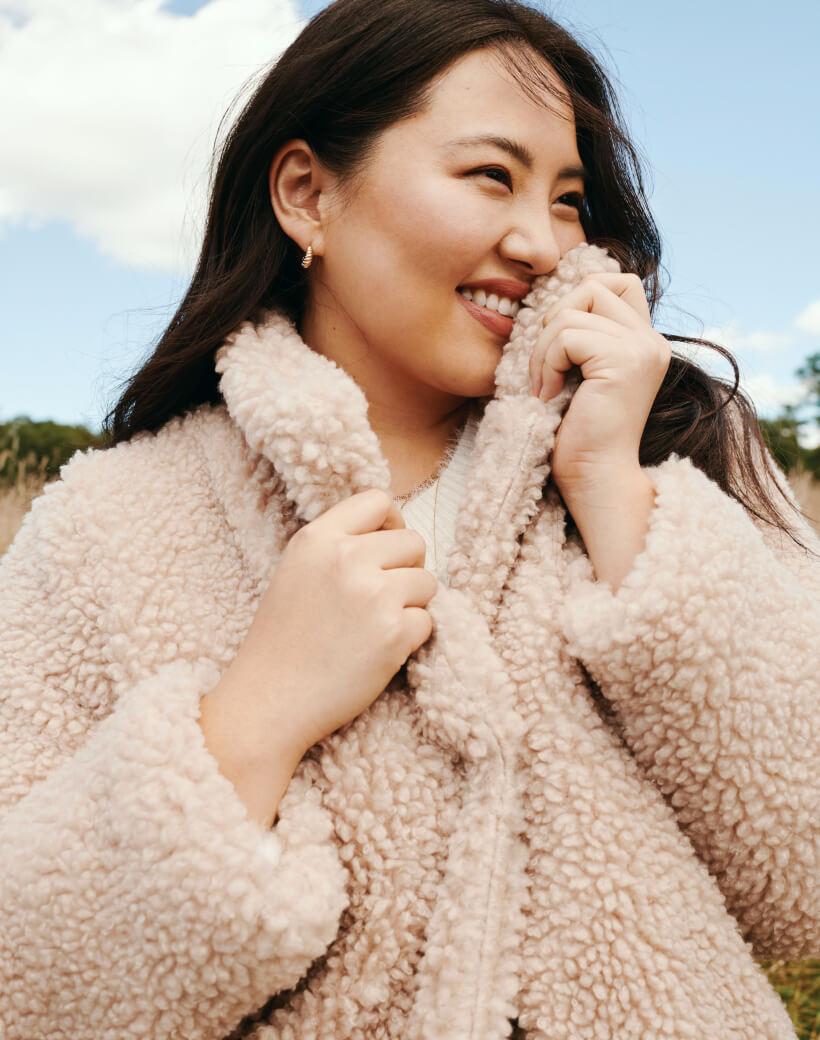Plus Woman in Beige Furry Jacket