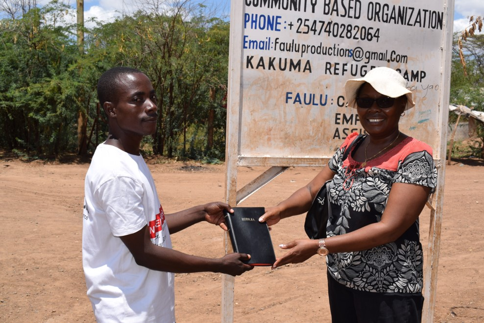 Pastor Shama from Congo receiving a Swahili Bible from Bernice Gatere Executive Director of TWRKenya.jpg