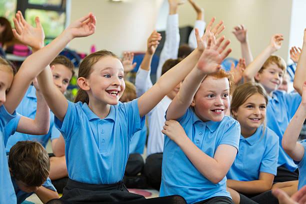 classroom children hands up