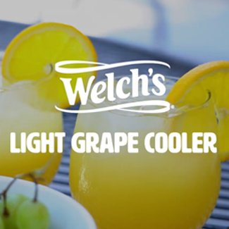 Welchs Light Grape Cooler iced drinks with lemon wedges.
