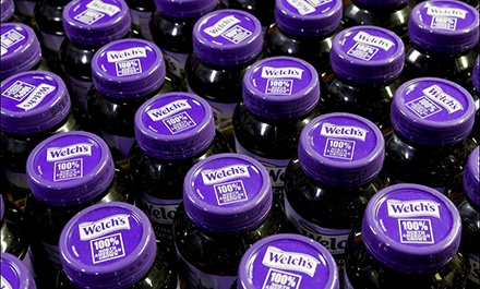 Aerial view of Welch's 100% Concord Grape Juice bottles.