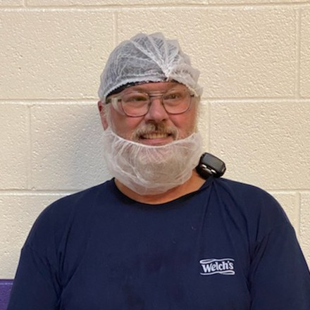 Welch's staff member smiling at work.