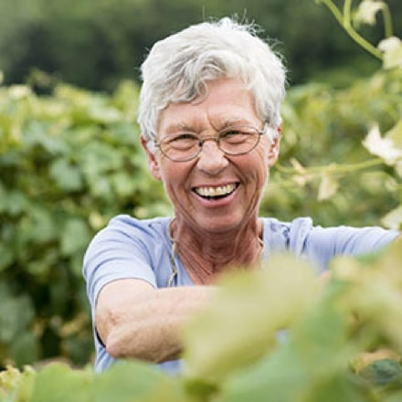Portrait of a Welch's co-op farmer smiling in a vineyard