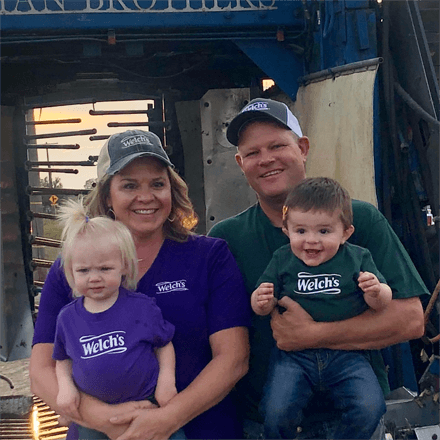 Paul Killian, Welch's Farmer, and his wife and two children, all wearing Welch's tees.