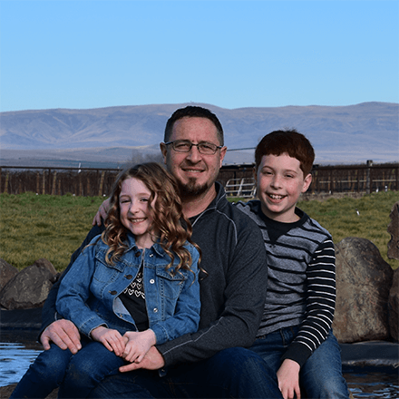 Todd Wheeler, Welch's Farmer, and his two children on their Concord Grape farm.