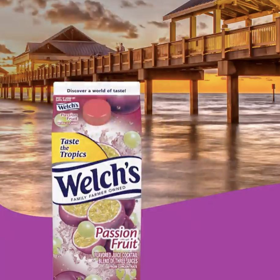 Welch's Passion Fruit container with an ocean sunset in the background.