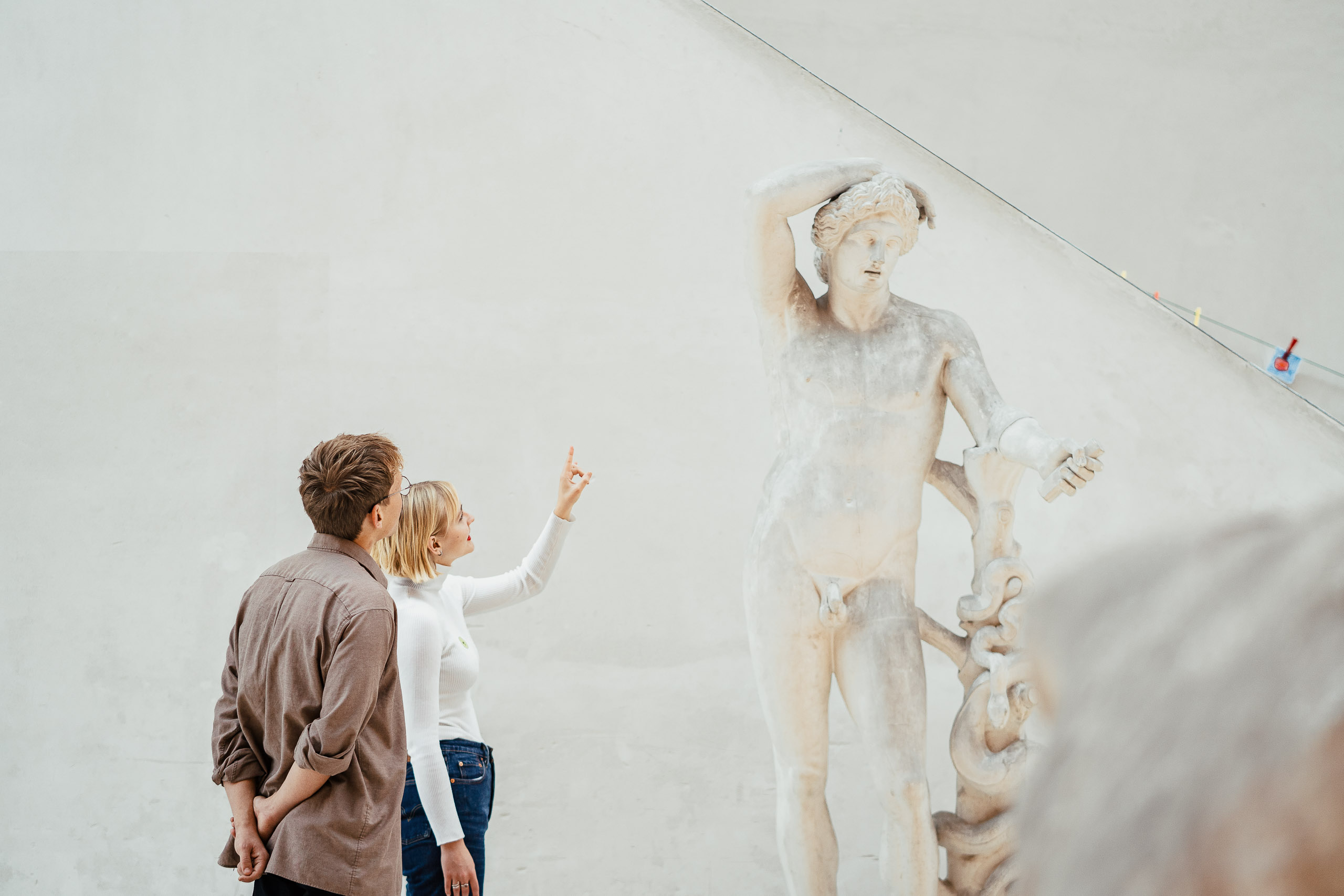 Visitors are watching art at National Gallery of Denmark.