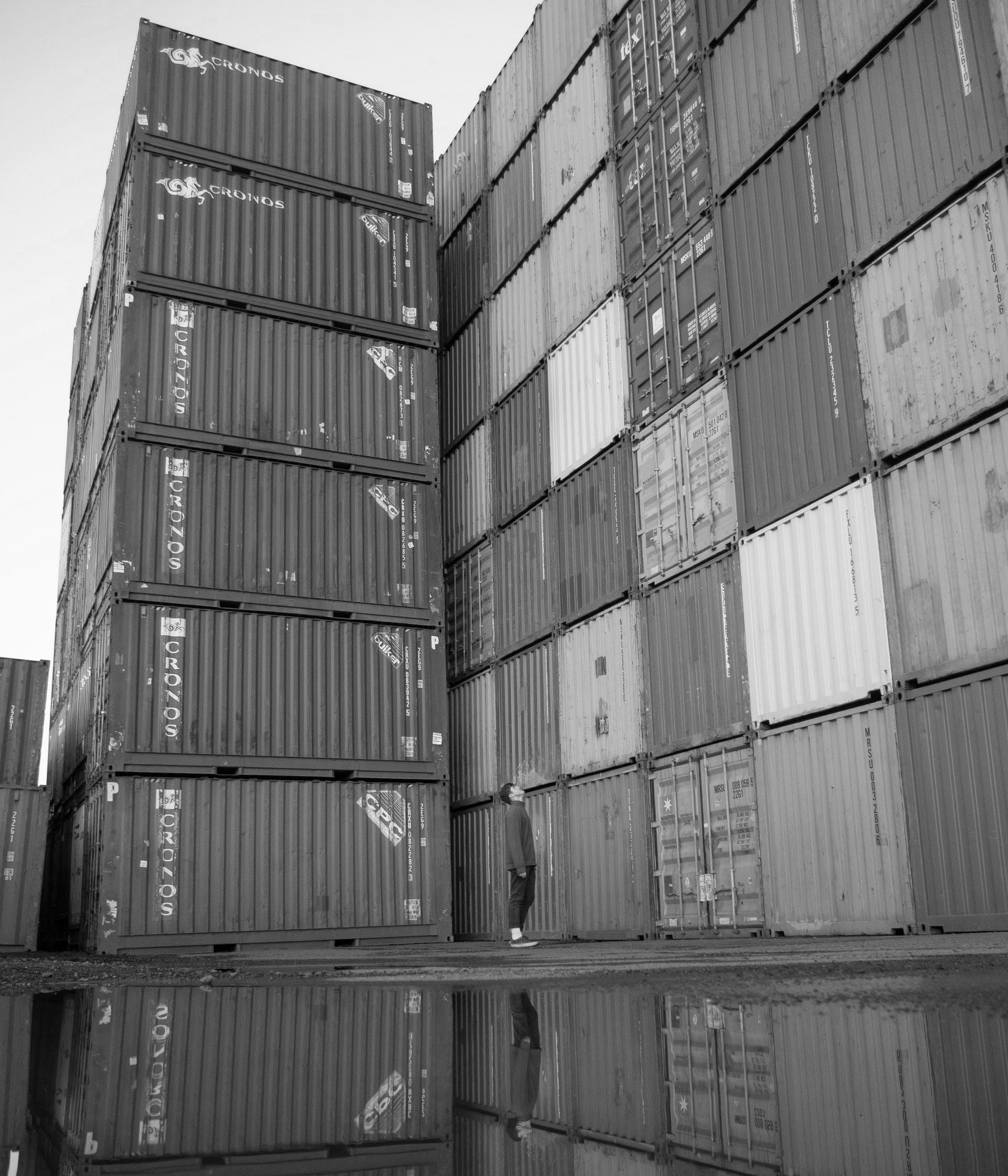 Person watching containers image