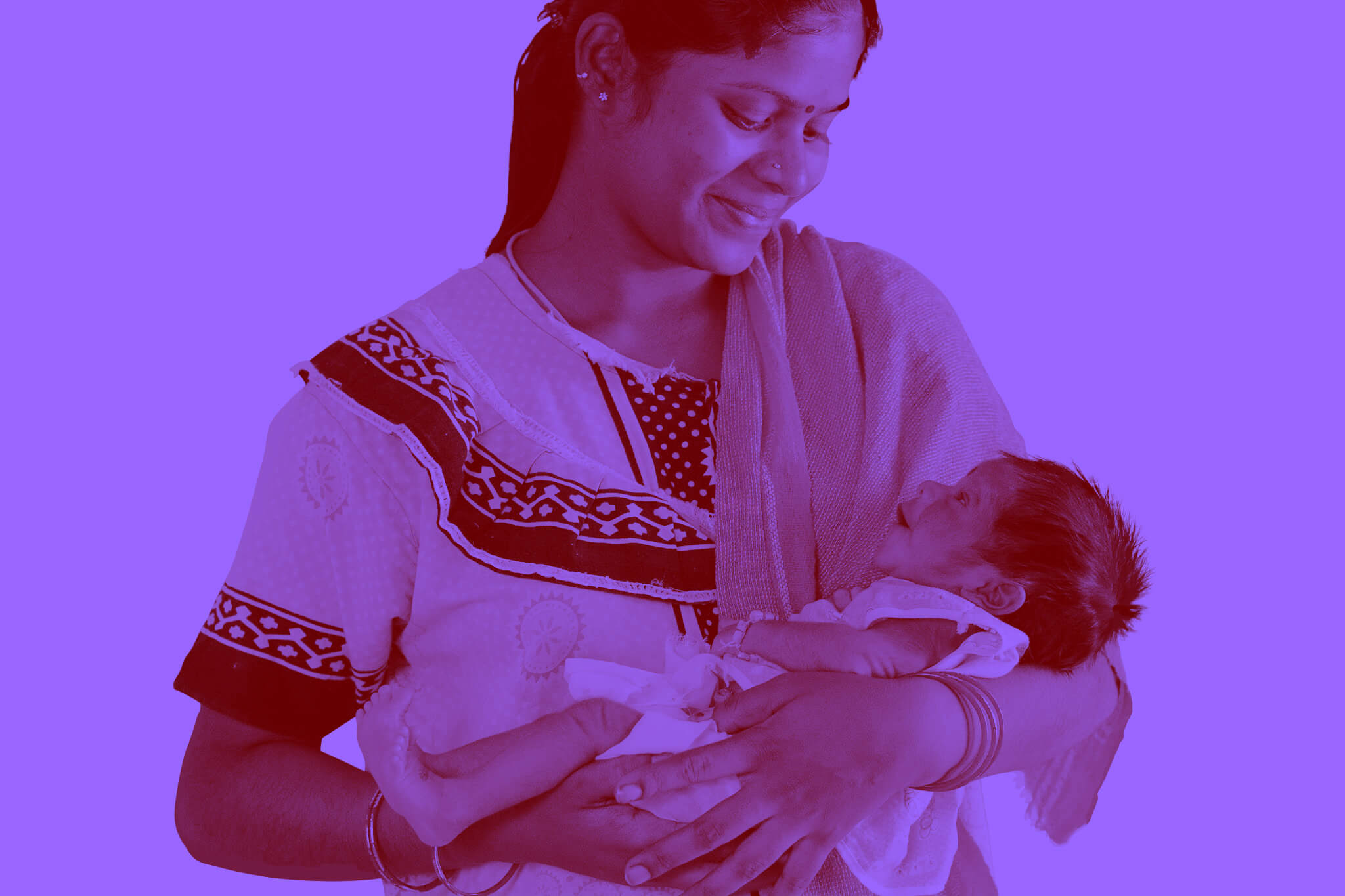 Indian mother holding baby girl