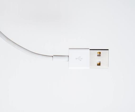 A picture of a white USB cable on a grey background