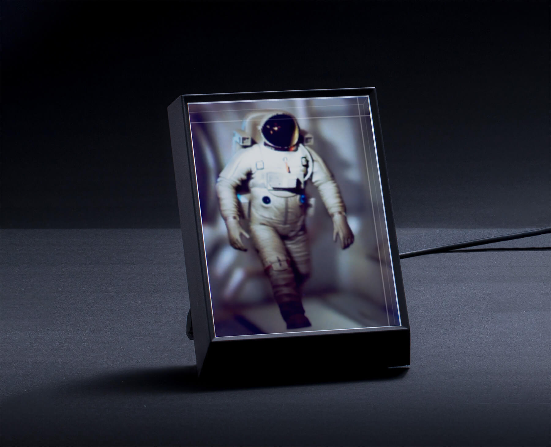 An astronaut walking in the Looking Glass Portrait holographic display