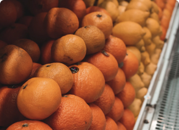 Close up of Oranges stacked at the market